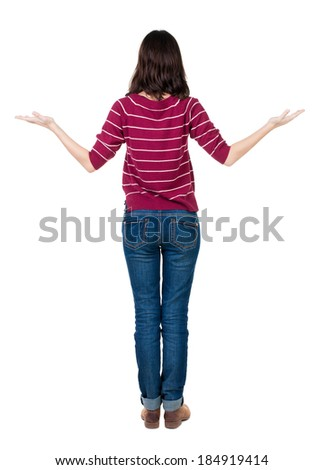 Back view of Beautiful woman holds hand up. Rear view people collection.  backside view of person.  Isolated over white background. - stock photo