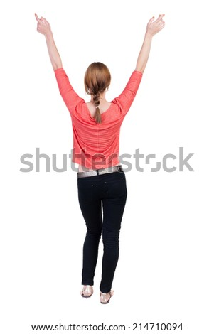 Back view of Beautiful woman in jeans looking at wall and Holds  hand up.  young blonde girl standing. Rear view people. Isolated over white background.