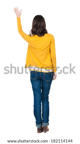 Back view of beautiful woman welcomes. Young girl hand waving from. Rear view  people collection.  backside view of person.  Isolated over white background. - stock photo