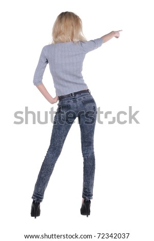 Back view of beautiful young blonde woman pointing at wall. Rear view people series. Isolated over white background.