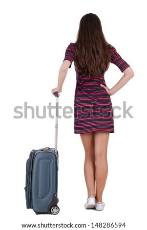 Back view of brunette woman with suitcase looking up. Standing young girl. Rear view people collection.  backside view of person. Isolated over white background.  - stock photo
