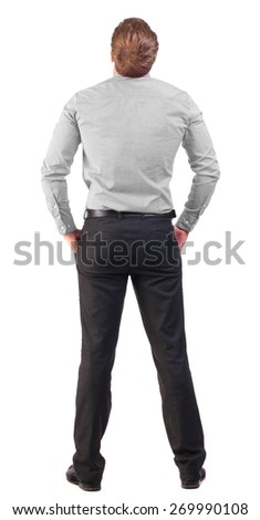 back view of Business man  looks ahead. Young guy in pink shirt watching.   backside view of person.  Isolated over white background. broad-office worker with his hands in his pockets looking to sky - stock photo