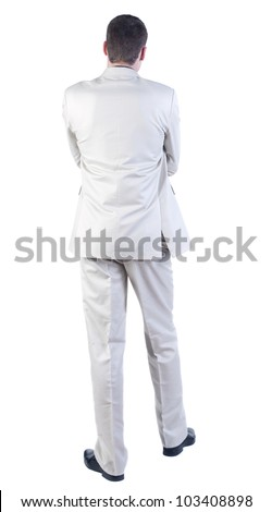 back view of Business man  looks ahead. Young guy in white suit watching.   Rear view people collection.  backside view of person.  Isolated over white background. - stock photo