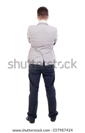 back view of Business man  looks.  Rear view people collection.  backside view of person.  Isolated over white background. The guy put his hands on his chest. - stock photo