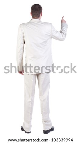 back view of Business man  pointing. Young guy in white suit.   Rear view people collection.  backside view of person.  Isolated over white background. - stock photo