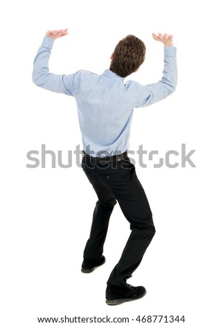 back view of business man protects hands from what is falling from above. Man holding a heavy load. Rear view people collection.  backside view of person.  Isolated over white background. The curly