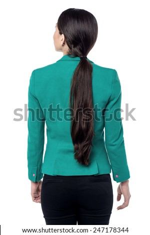 Back view of business woman looking up - stock photo