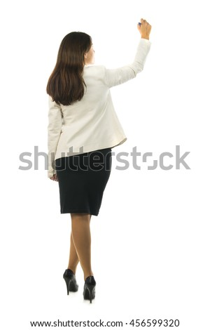 Back view of business woman writing something on white wall background, place for your design or text