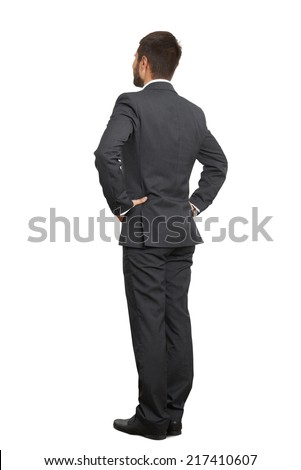 back view of businessman in black suit with hands on belt. isolated on white background