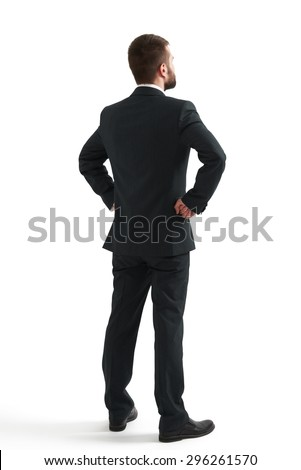 back view of businessman in formal wear looking up at something. isolated on white background - stock photo