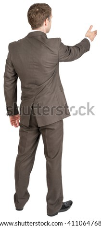 Back view of businessman in suit out to shake hand. Isolated over white background - stock photo