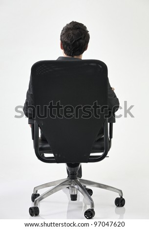 back view of businessman sitting at the chair - stock photo