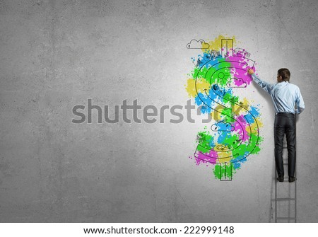 Back view of businessman standing on ladder and drawing on wall - stock photo