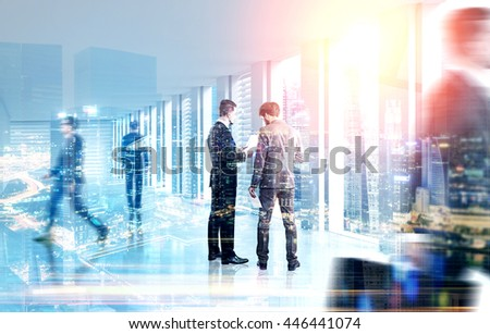 Back view of businessmen discussing something on city background with sunlight. Teamwork concept. Double exposure - stock photo