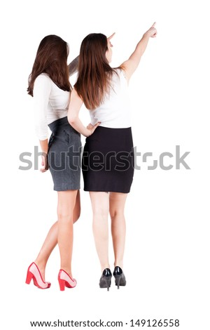 back view of businessteam. two young  business woman pointing.  Rear view people collection.  backside view of person.  Isolated over white background. - stock photo