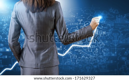Back view of businesswoman drawing business strategy sketch