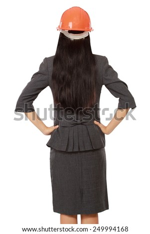 back view of businesswoman in builder helmet, isolated on white background - stock photo