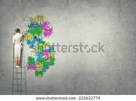 Back view of businesswoman standing on ladder and drawing on wall