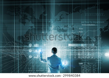 Back view of businesswoman working with modern virtual technologies - stock photo