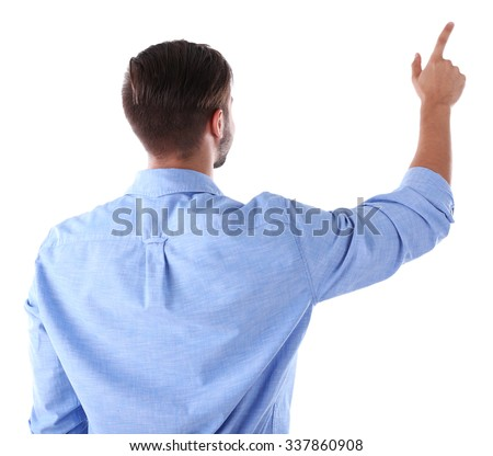 Back view of Caucasian young man in a blue shirt pointing, isolated on white - stock photo