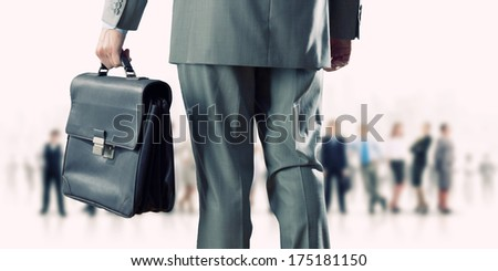 Back view of confident businessman with business team at background - stock photo