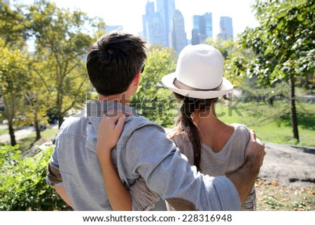 Back view of couple in Central Park enjoying skyline - stock photo