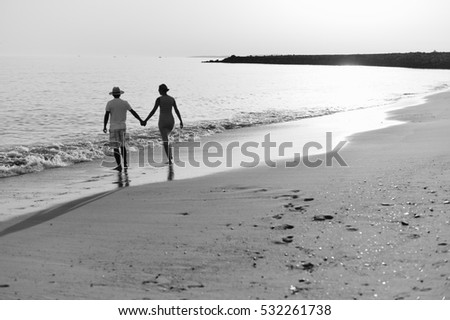 Back view of couple on holiday travel vacation beach. sunny ocean sky background