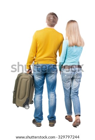 Back view of couple with  green suitcase looking up. Rear view people collection.  backside view of person.  Isolated over white background.  - stock photo