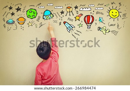 back view of cute kid imagine space travel with set of infographics over textured wall background - stock photo