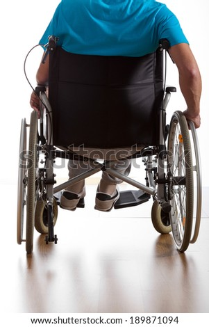 Back view of disabled patient on isolated white background - stock photo