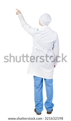 Back view of doctor in robe pointing. Standing young guy. Rear view people collection.  backside view of person.  Isolated over white background.