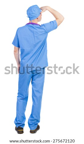 Back view of doctor in robe. Standing young guy. Rear view people collection.  backside view of person.  Isolated over white background. Paramedic is putting his hand to the face - stock photo