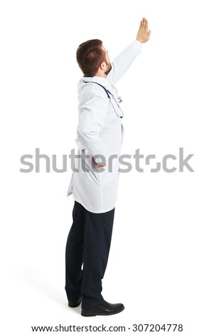 back view of doctor in white smock raising his hand up and showing stop sign. isolated on white background - stock photo