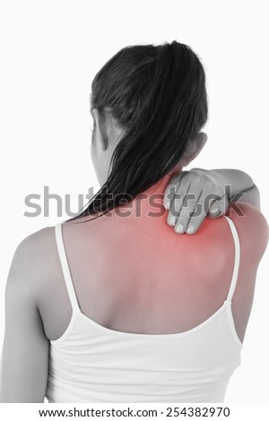 Back view of female with pain in her neck against a white background - stock photo