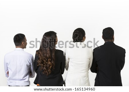 Back view of four indian business people. Isolated over white background - stock photo