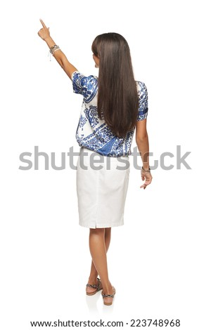 Back view of full length business woman in pointing at copy space, isolated on white - stock photo