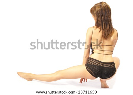 Back view of girl with one leg extended