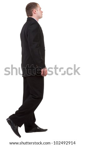 back view of going business man. walking young guy in black suit. Isolated over white background. Rear view people collection.  backside view of person. - stock photo