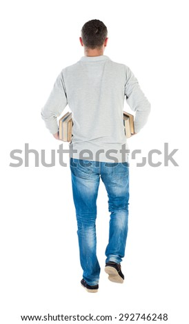 Back view of going  handsome man carries a stack of books. walking young guy . Rear view people collection.    Isolated over white background. The guy in the white jacket of the book carries armpits. - stock photo