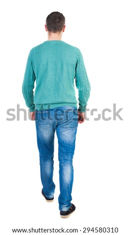 Back view of going  handsome man in jeans and a shirt.  walking young guy . Rear view people collection.  backside view of person.  Isolated over white background. The guy in the green jacket goes on - stock photo