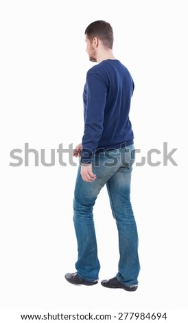 Back view of going  handsome man. walking young guy . Rear view people collection.  backside view of person.  Isolated over white background.  guy in jeans goes to the right. - stock photo