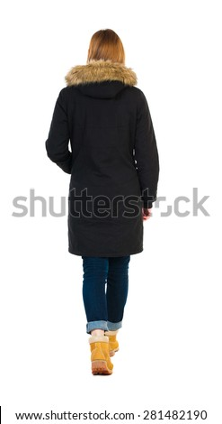 Back view of going  woman in parka. walking young girl. Rear view people collection.  backside view of person.  Isolated over white background.  Blonde girl in winter clothes out - stock photo