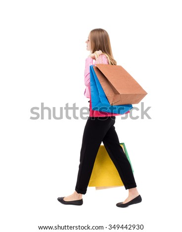 back view of going woman  with shopping bags. beautiful girl in motion.  backside view of person. Isolated over white background. woman is left businessman with lots of bags. throwing them on shoulder - stock photo