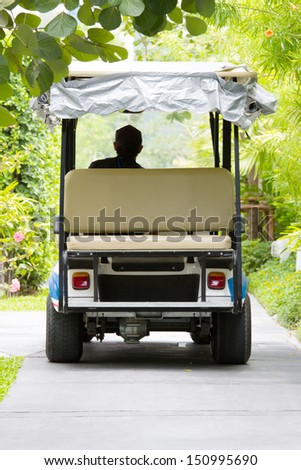 back view of golf cart in the road - stock photo