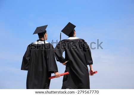 Back view of graduates student look blue sky and think future - stock photo