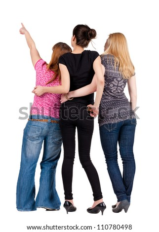 Back view of group young women pointing . Girl looks into the distance.  Rear view people collection. backside view of person. Isolated over white background. - stock photo