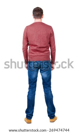 Back view of handsome man in blue pullover looking up.   Standing young guy in jeans. Rear view people collection.  backside view of person.  Isolated over white background. - stock photo