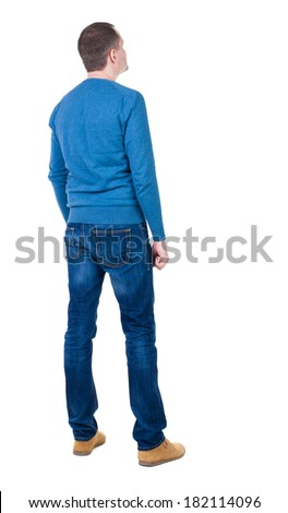 Back view of handsome man in blue pullover. Standing young guy in cardigan. Rear view people collection.  backside view of person.  Isolated over white background.