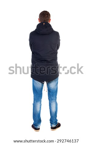Back view of handsome man in winter jacket  looking up.   Standing young guy in parka. Rear view people collection.  backside view of person.  Man in warm jacket put his hands on his chest and costs.