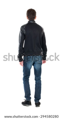 Back view of handsome man in winter jacket  looking up.   Standing young guy in parka. Rear view people collection.  Isolated over white background. A guy in black jacket standing and looking forward.